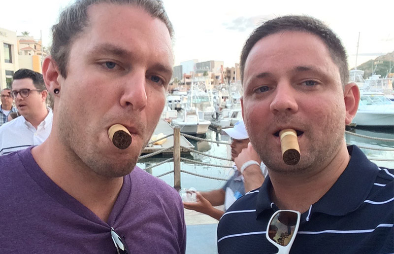 Hey, it's hard to smile with a cigar in your mouth!