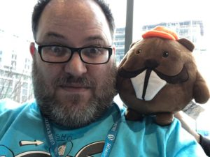 People at WordCamp US with stuffed beavers.